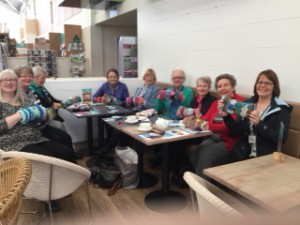 The Needlework group ladies handing over their Twiddlemuffs
